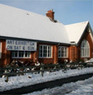 View of village hall with snow on roof